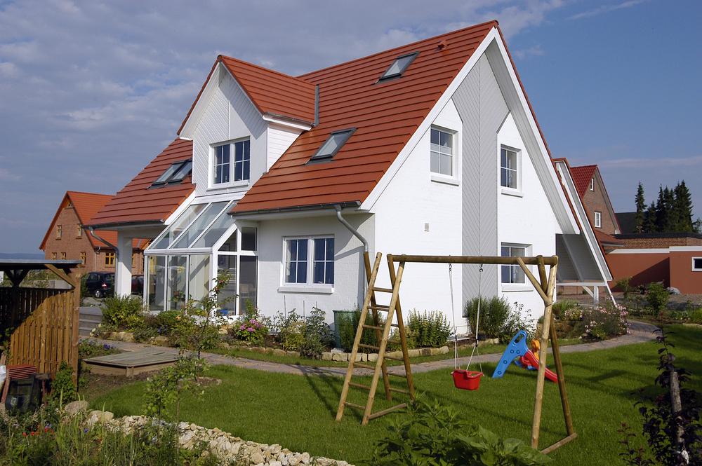 Haus mit kleinem Wintergarten